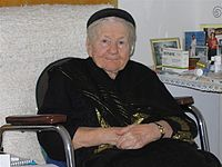 Irena Sendler, age 97, smiling from her wheelchair